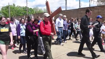 Parishioners from the Catholic Diocese of Alexandria walk in the annual Passion Walk