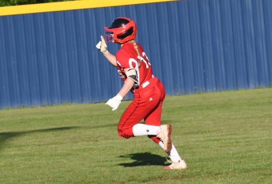 Tioga second baseman Natalie Martin (13) points to the sky after hitting a home run against Buckeye in the 2019 Allstate Sugar Bowl/LHSAA Softball State Tournament Class 4A quarterfinals held Friday, April 19, 2019. Buckeye won 4-3.
