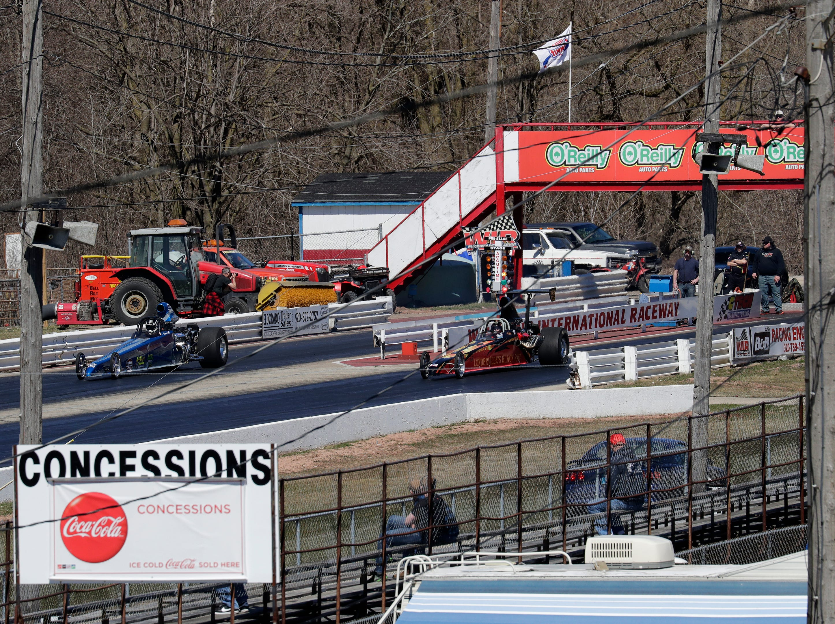 Dragsters take test runs during the Wisconsin International Raceway Strip Test & Tune event Saturday, April 20, 2019, in Kaukauna, Wis. Drivers spent the day getting safety inspections, tune ups and test runs on the track for the upcoming season.
