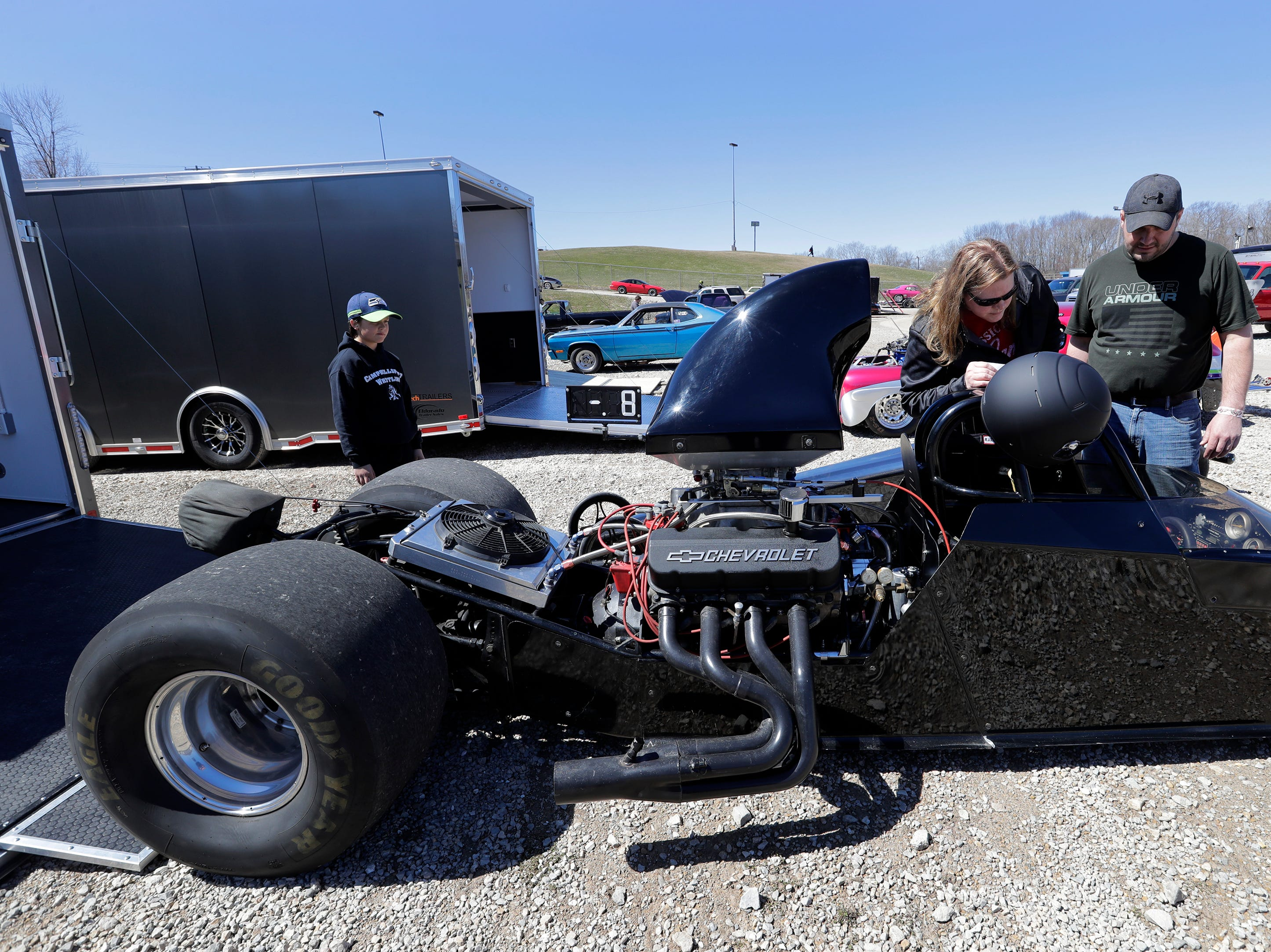 Sarah Bentz of Eden and her husband Keith make adjustments to their rear engine dragster during the Wisconsin International Raceway Strip Test & Tune event Saturday, April 20, 2019, in Kaukauna, Wis. At left is their sun Levi, 9. Drivers spent the day getting safety inspections, tune ups and test runs on the track for the upcoming season.