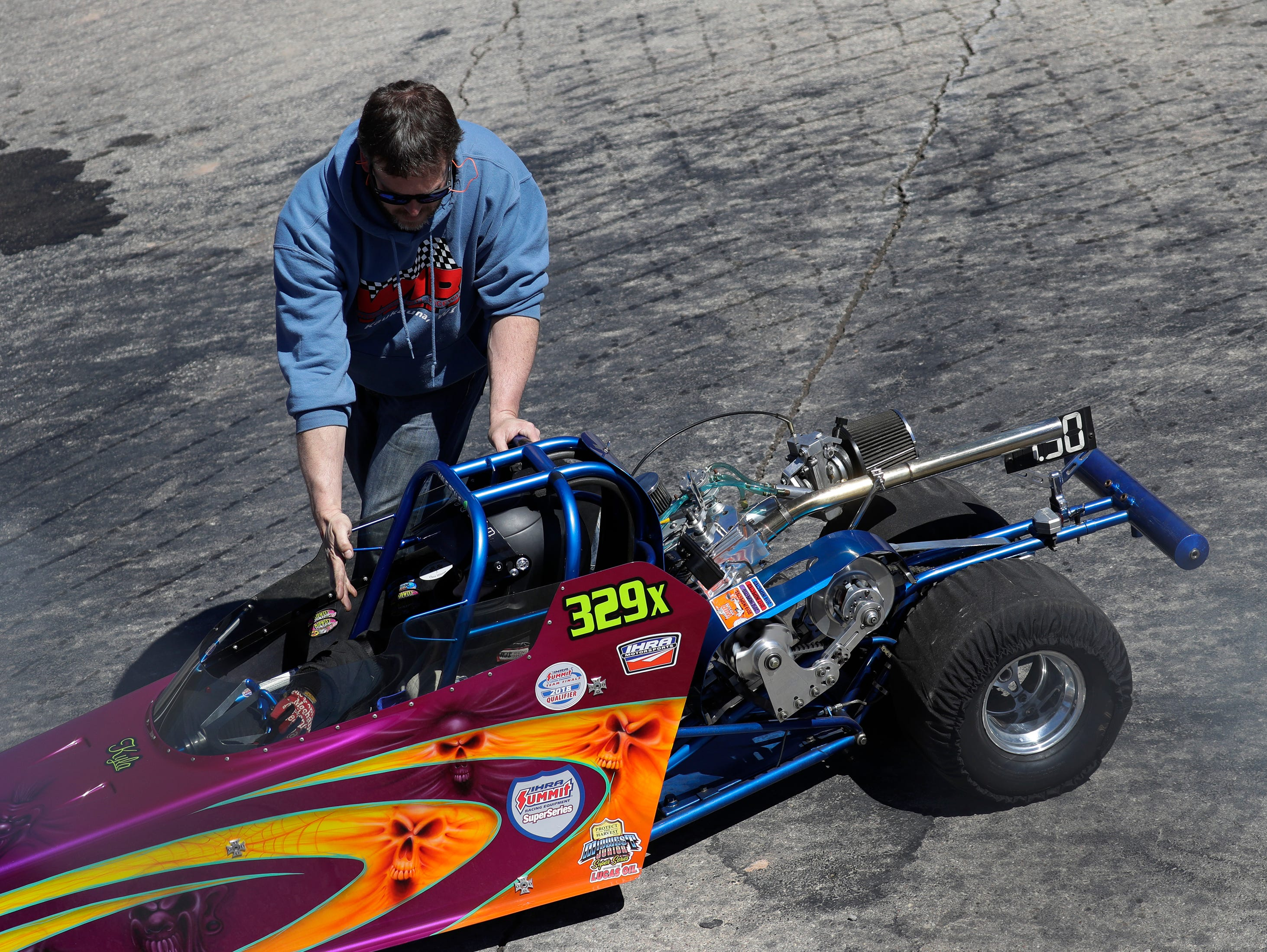 A junior racer is guided to the starting line for a test run during the Wisconsin International Raceway Strip Test & Tune event Saturday, April 20, 2019, in Kaukauna, Wis. Drivers spent the day getting safety inspections, tune ups and test runs on the track for the upcoming season.
