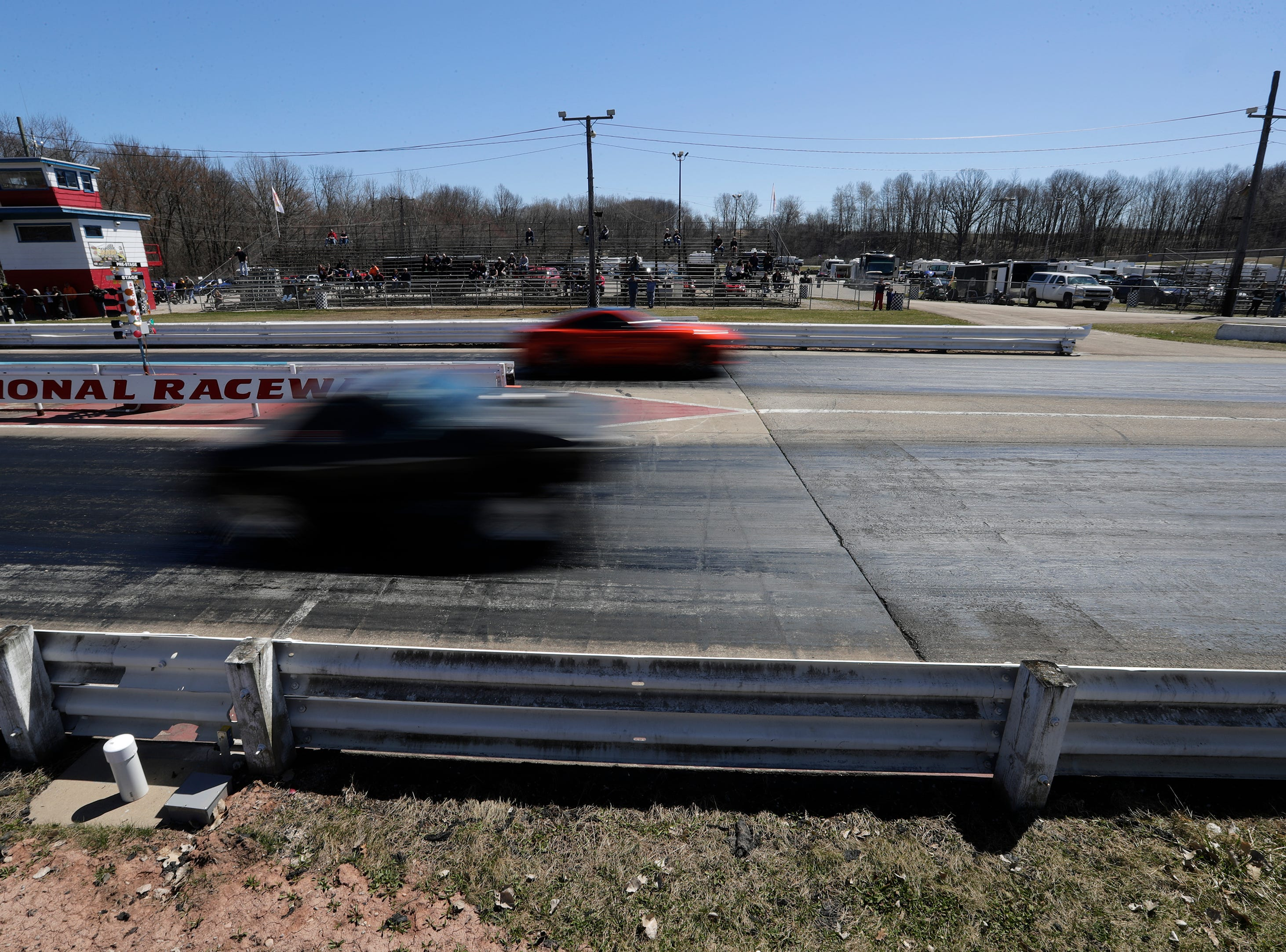 Cars race down the dragstrip during the Wisconsin International Raceway Strip Test & Tune event Saturday, April 20, 2019, in Kaukauna, Wis. Drivers spent the day getting safety inspections, tune ups and test runs on the track for the upcoming season.
