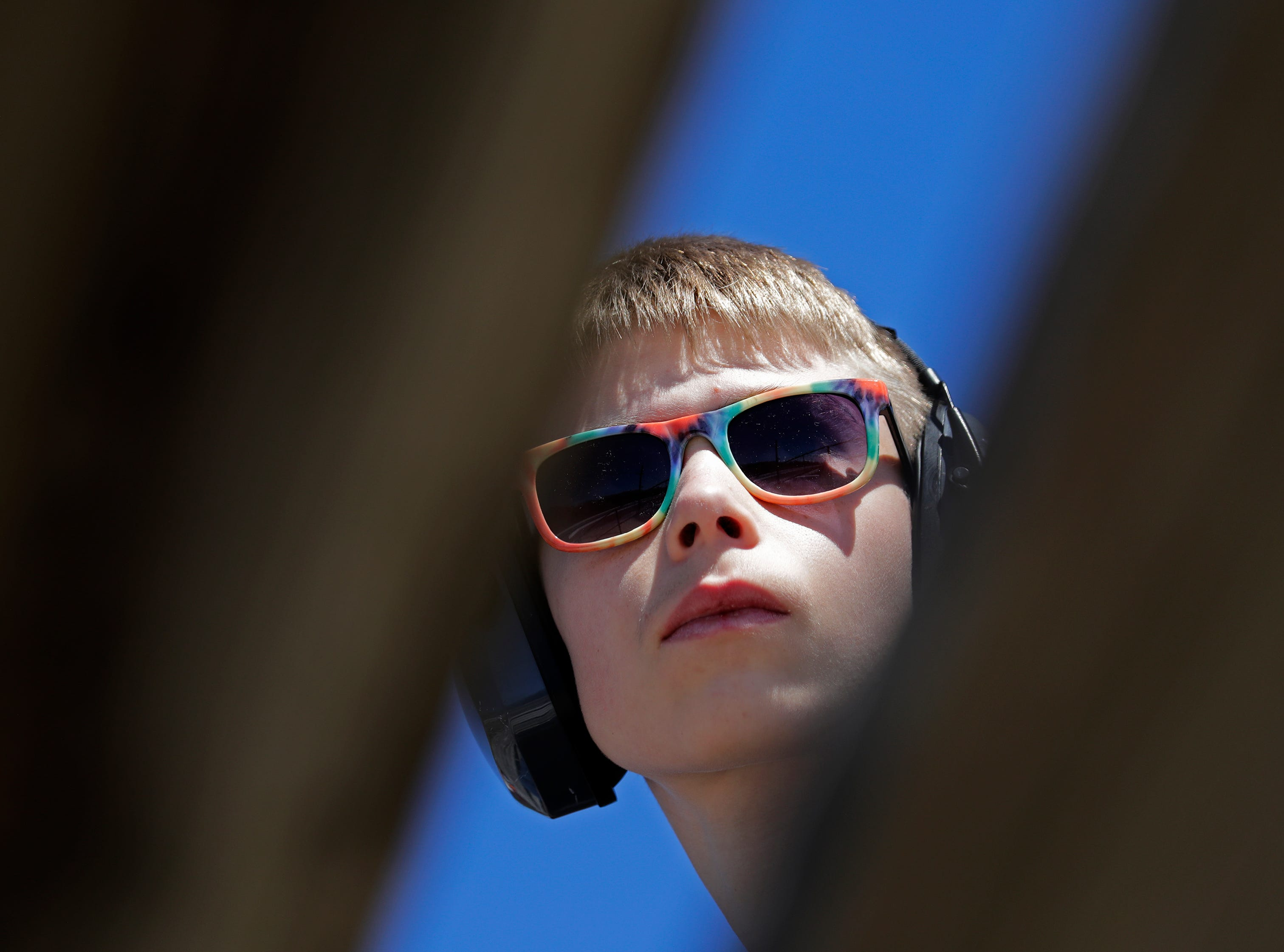 Colby Gill, 14, of Neenah keeps his eyes on the action during the Wisconsin International Raceway Strip Test & Tune event Saturday, April 20, 2019, in Kaukauna, Wis. Drivers spent the day getting safety inspections, tune ups and test runs on the track for the upcoming season.