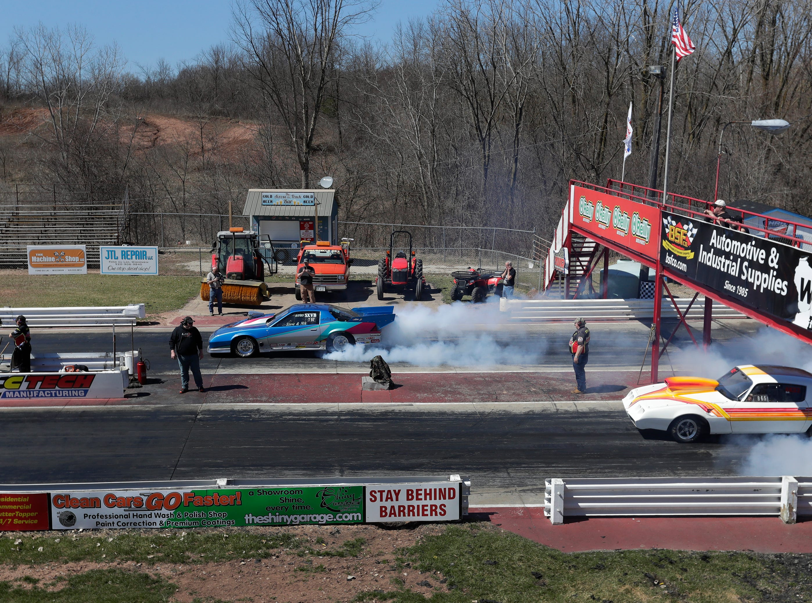 Cars do burn outs before their test run during the Wisconsin International Raceway Strip Test & Tune event Saturday, April 20, 2019, in Kaukauna, Wis. Drivers spent the day getting safety inspections, tune ups and test runs on the track for the upcoming season.