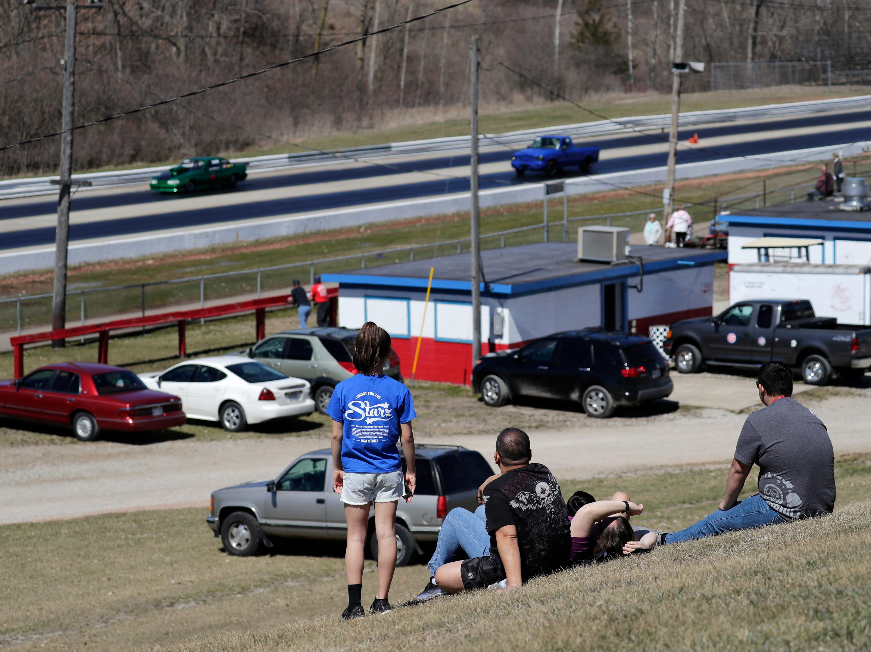 Fans watch from a distance during the Wisconsin International Raceway Strip Test & Tune event Saturday, April 20, 2019, in Kaukauna, Wis. Drivers spent the day getting safety inspections, tune ups and test runs on the track for the upcoming season.