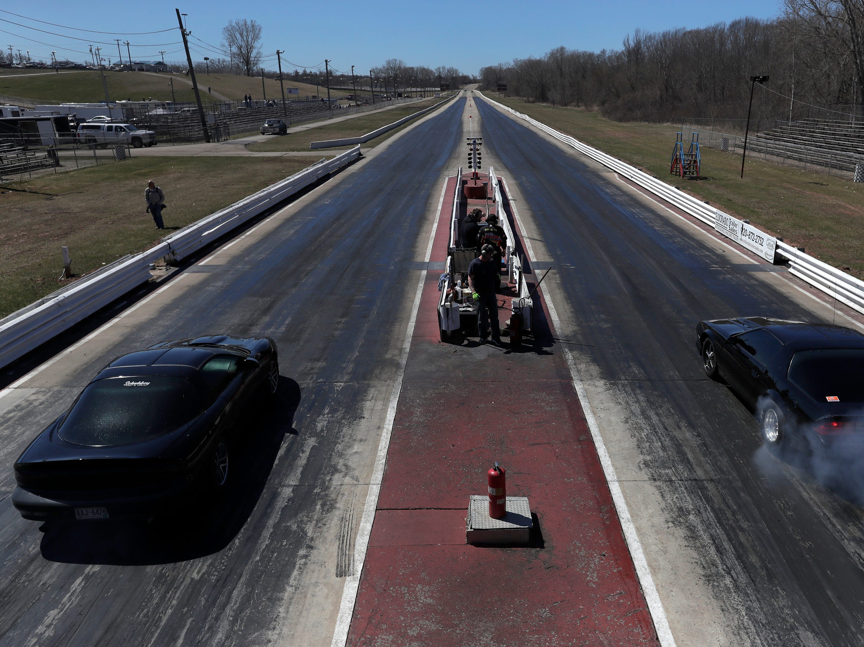 Cares take off down the dragstrip during the Wisconsin International Raceway Strip Test & Tune event Saturday, April 20, 2019, in Kaukauna, Wis. Drivers spent the day getting safety inspections, tune ups and test runs on the track for the upcoming season.