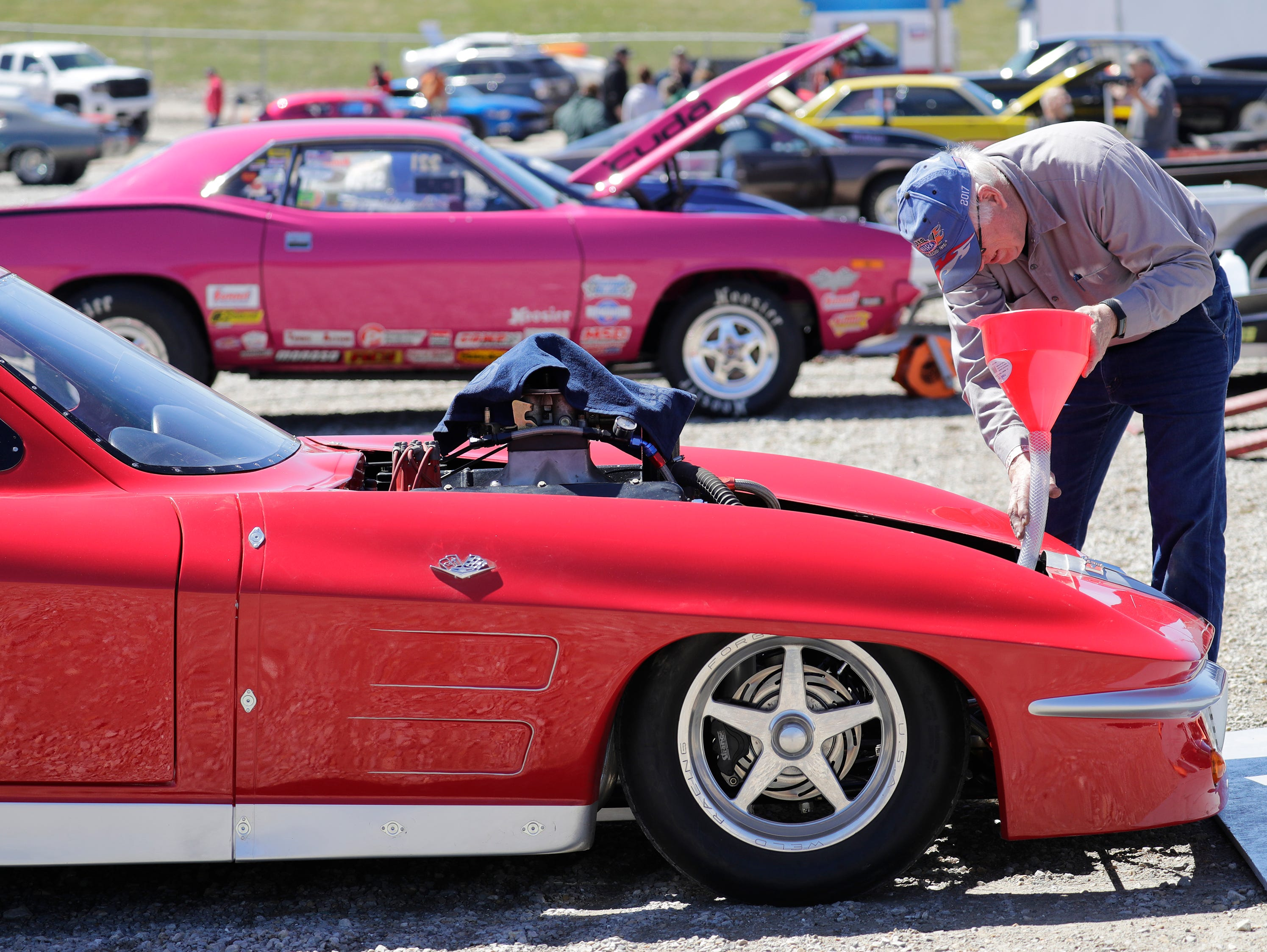 Dean Rentmeester of Fond du lac fuels his 1963 Corvette during the Wisconsin International Raceway Strip Test & Tune event Saturday, April 20, 2019, in Kaukauna, Wis. Drivers spent the day getting safety inspections, tune ups and test runs on the track for the upcoming season.