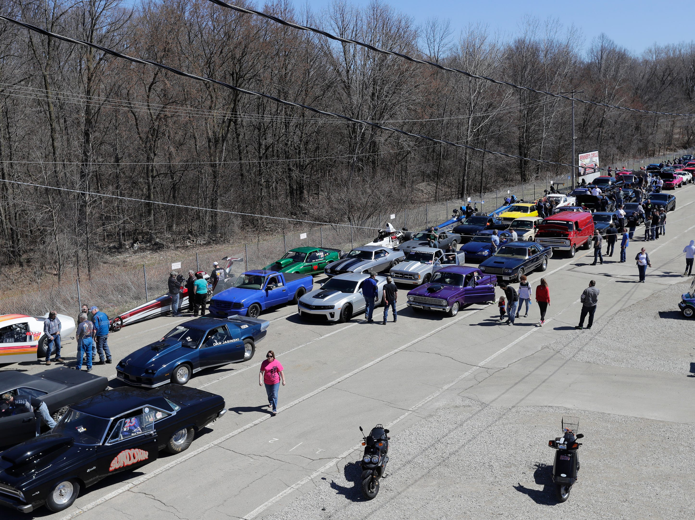 Vehicles line up for their practice runs during the Wisconsin International Raceway Strip Test & Tune event Saturday, April 20, 2019, in Kaukauna, Wis. Drivers spent the day getting safety inspections, tune ups and test runs on the track for the upcoming season.