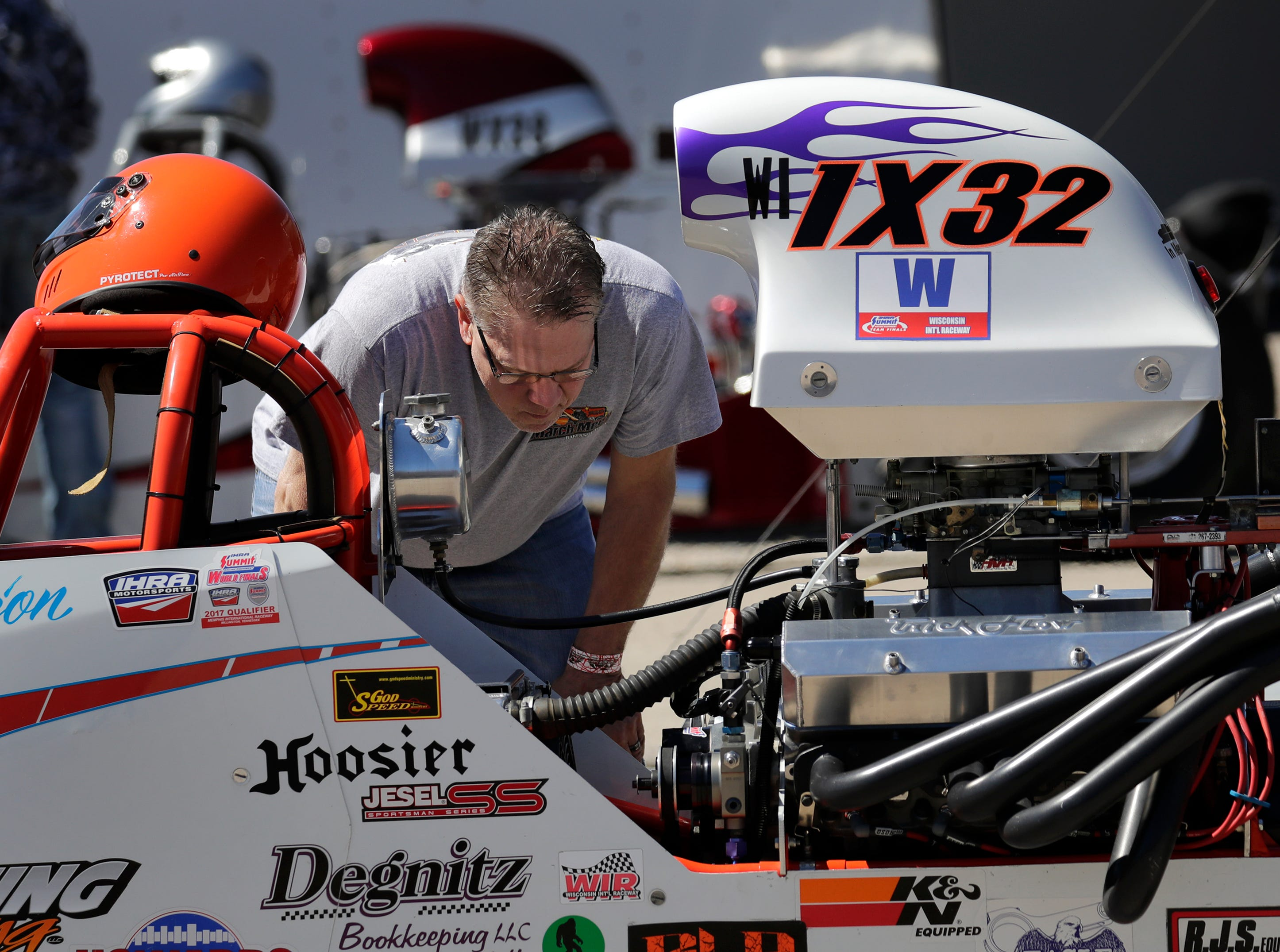 Dion Degnitz of Random Lake looks over his small block Chevy engine during the Wisconsin International Raceway Strip Test & Tune event Saturday, April 20, 2019, in Kaukauna, Wis.