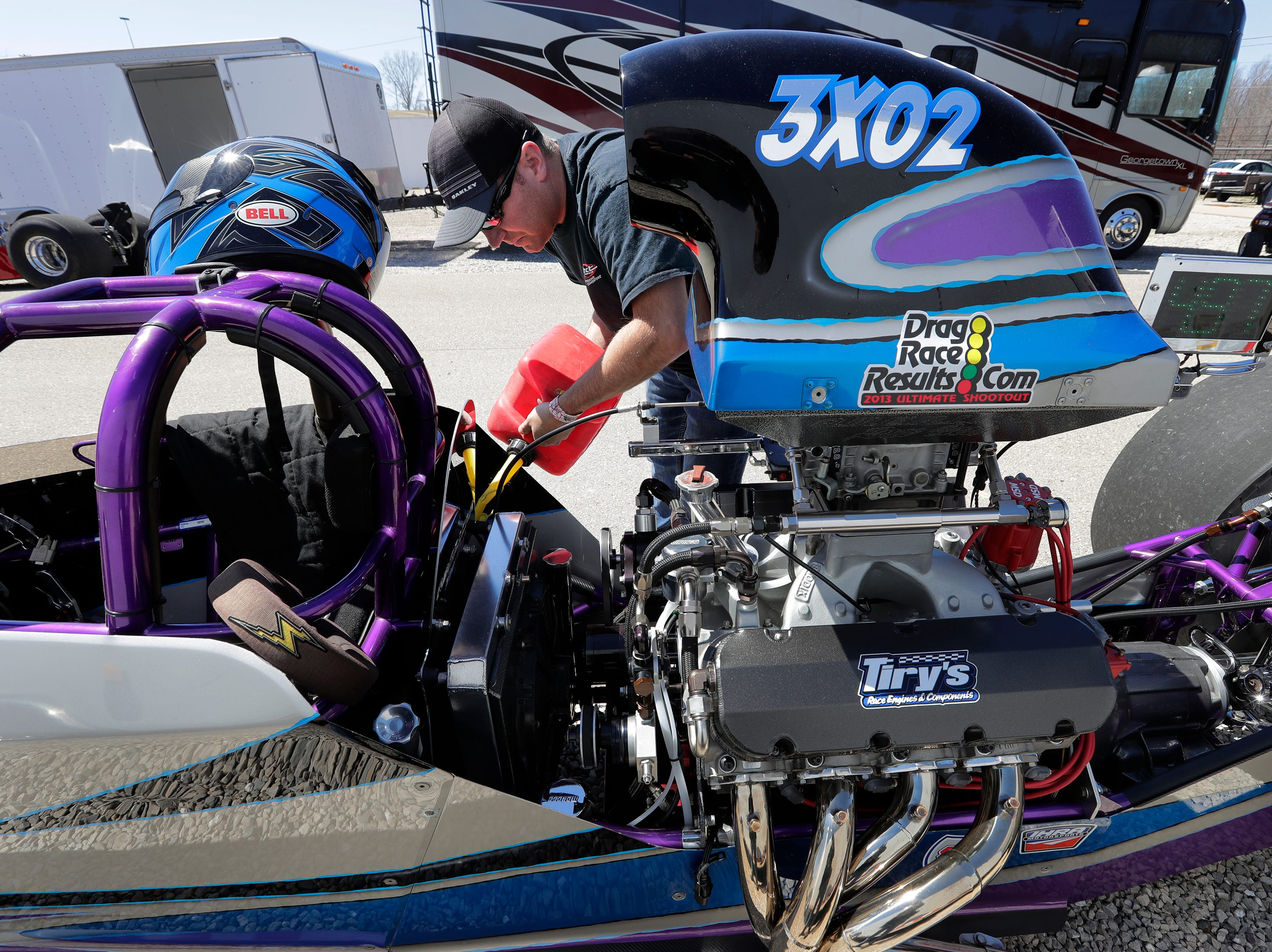 Derek Degnitz of Slinger prepares his dragster for a test run during the Wisconsin International Raceway Strip Test & Tune event Saturday, April 20, 2019, in Kaukauna, Wis. Drivers spent the day getting safety inspections, tune ups and test runs on the track for the upcoming season.