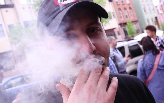 The Coalition for Medical Marijuana of New Jersey host a rally in front of the New Jersey statehouse to bring attention to marijuana legalization on the unofficial 420 holiday. Vyacheslav Rabinovitch of New Brunswick smokes in front of the statehouse. Trenton, NJSaturday, April 20, 2019