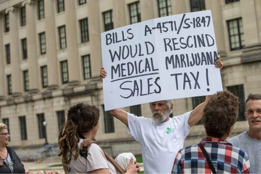 The Coalition for Medical Marijuana of New Jersey host a rally in front of the New Jersey statehouse to bring attention to marijuana legalization on the unofficial 420 holiday. Jim Miller, co-founder of CMMNJ protests about tax in front of the statehouse. Trenton, NJSaturday, April 20, 2019