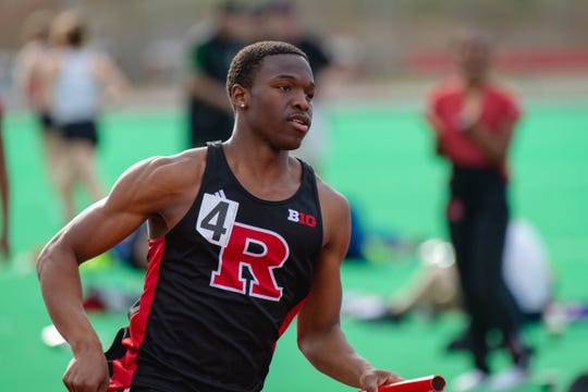 Chris Jenkins carries the baton for Rutgers' 4x400.