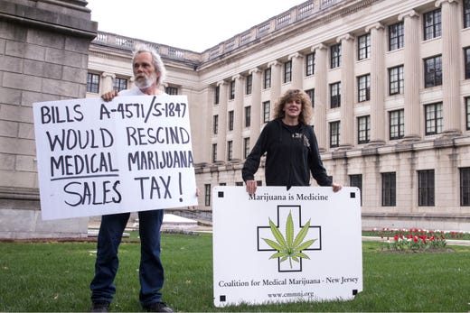 The Coalition for Medical Marijuana of New Jersey host a rally in front of the New Jersey statehouse to bring attention to marijuana legalization on the unofficial 420 holiday. Jim Miller, co-founder of CMMNJ and Kim Cushman of South Hampton protest about tax in front of the statehouse. Trenton, NJSaturday, April 20, 2019