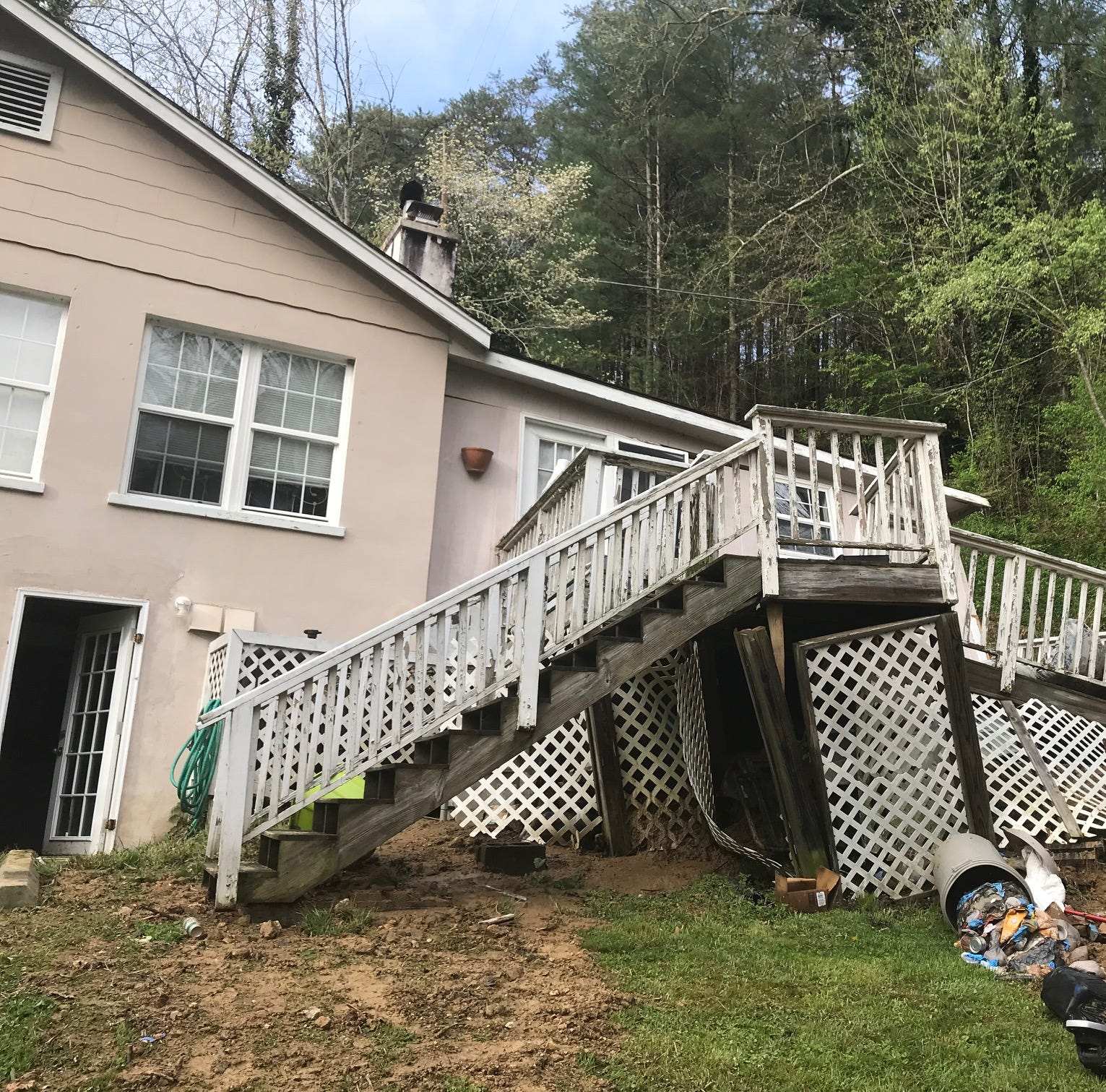 Landslide collapses apartment building in Marshall as French Broad rises