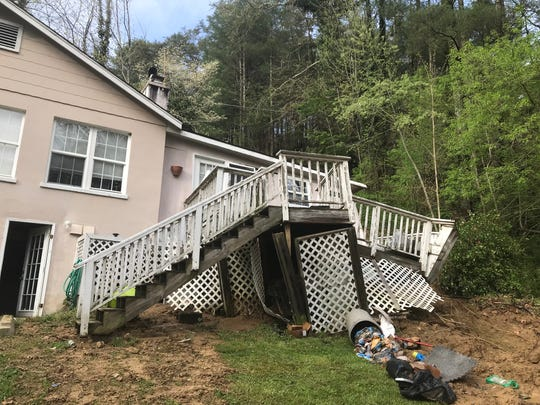 The back section of an apartment building on Walnut Creek Road in Marshall gave way due to a mudslide April 19.