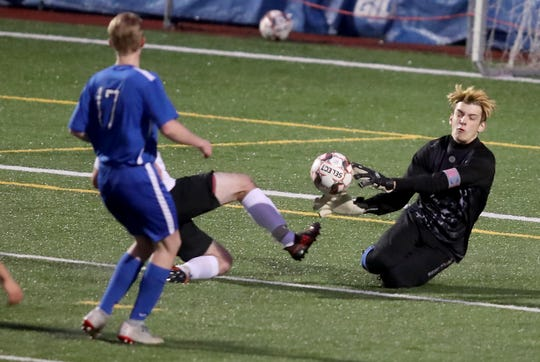 Olympic goalie Cadyn Kinsfather blocks a shot by Port Townsend's Zachary Dempsey at Silverdale Stadium on Friday, April 19, 2019.