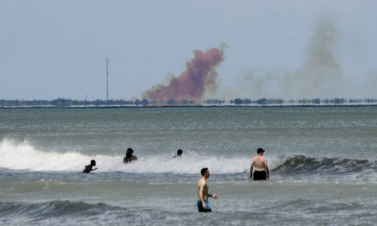 A cloud of orange smoke rises over the Cape as seen from Cocoa Beach.  SpaceX reported an anomaly during test firing of Dragon 2 Saturday afternoon. There are no reported injuries.