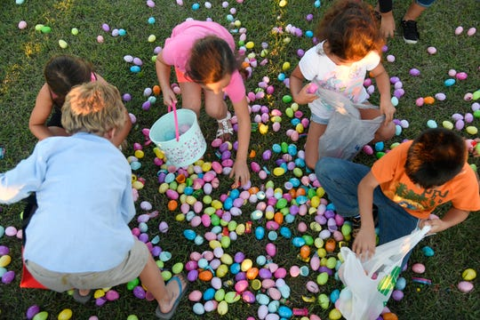 Children grab eggs during an Easter egg hunt, Thursday, April 18, 2019, at Church of Hope in Calallen.