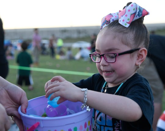 Clarissa Padilla, 5, opens her Easter eggs after an Easter egg hunt, Thursday, April 18, 2019, at Church of Hope in Calallen.