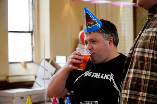 """Travis Ramey at Urban Artifact's fourth anniversary party, April 20, 2019. Ramey has been visiting the brewery since 2015 after his friends """"said there was beer here."""""""