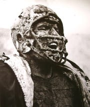 Forrest Gregg cheers a good play by the Green Bay Packers defense while covered in mud in a game against the 49ers at Kezar Stadium in San Francisco, Dec. 10, 1960.