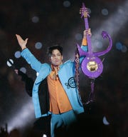 Prince performs during the halftime show of the Super Bowl XLI football game at Dolphin Stadium in Miami in 2007.