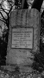 The granite monument shown was erected in Newtown in memory of Dr. John Lambert Richmond, who performed the nation's first Caesarean section there back in 1827.