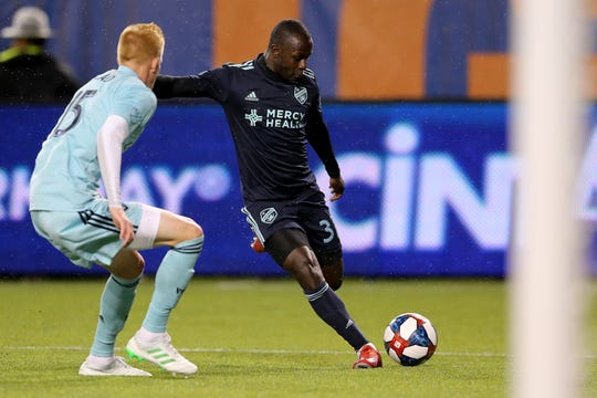 FC Cincinnati forward Kekuta Manneh (31) takes a shot son goal as Real Salt Lake defender Justen Glad (15) defends in the second half of an MLS soccer game, Friday, April 19, 2019, at Nippert Stadium in Cincinnati.
