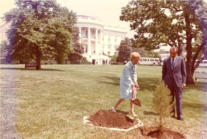 President Richard Nixon and First Lady Pat Nixon plant a tree on the White House South Lawn to recognize the first Earth Day in 1970.