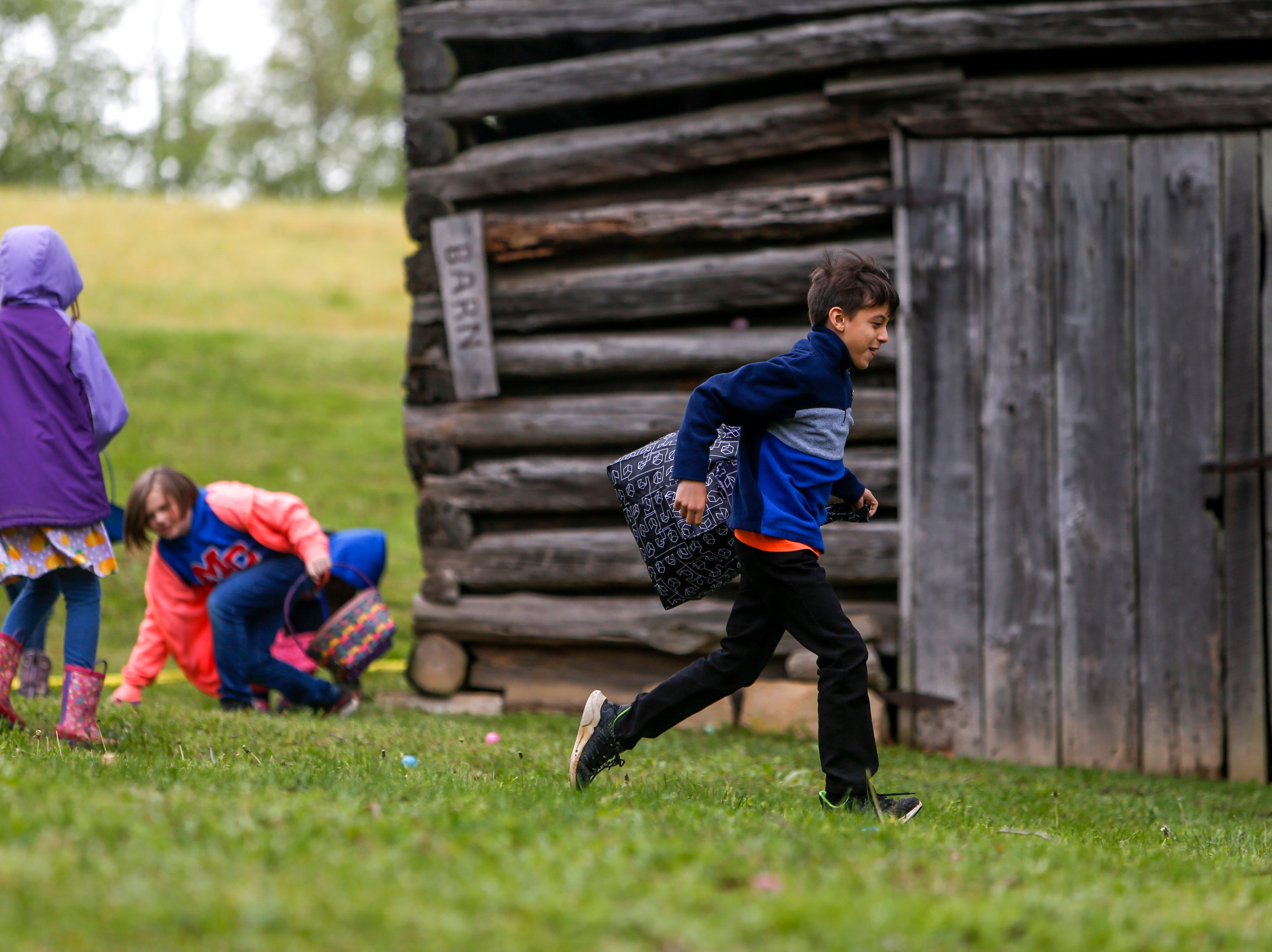 Egg hunters sprint into action in search of eggs at the annual Easter egg hunts at Historic Collinsville in Clarksville, Tenn., on Saturday, April 20, 2019.