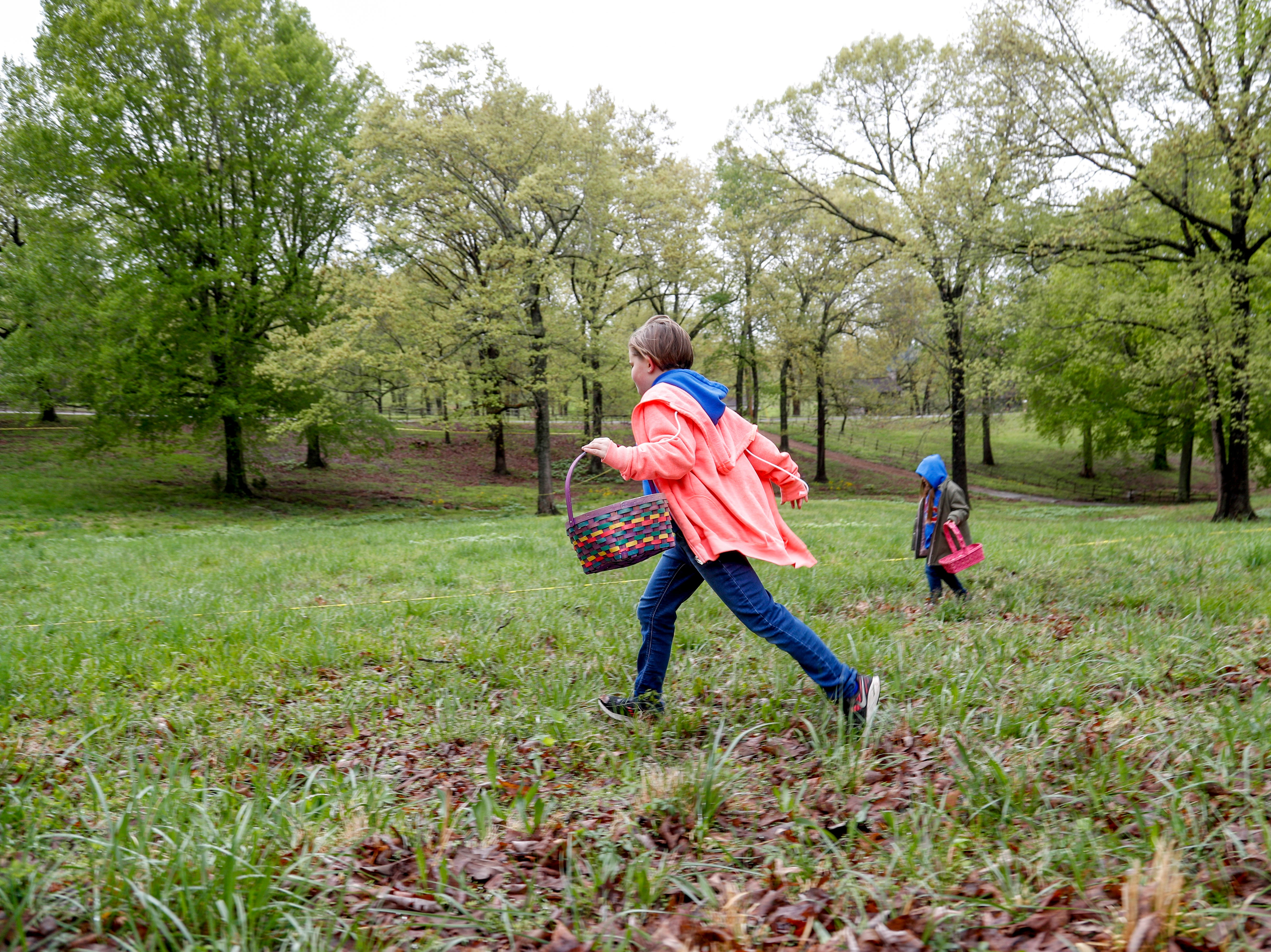 Egg hunters sprint through the grass in search of eggs including a golden one at the annual Easter egg hunts at Historic Collinsville in Clarksville, Tenn., on Saturday, April 20, 2019.