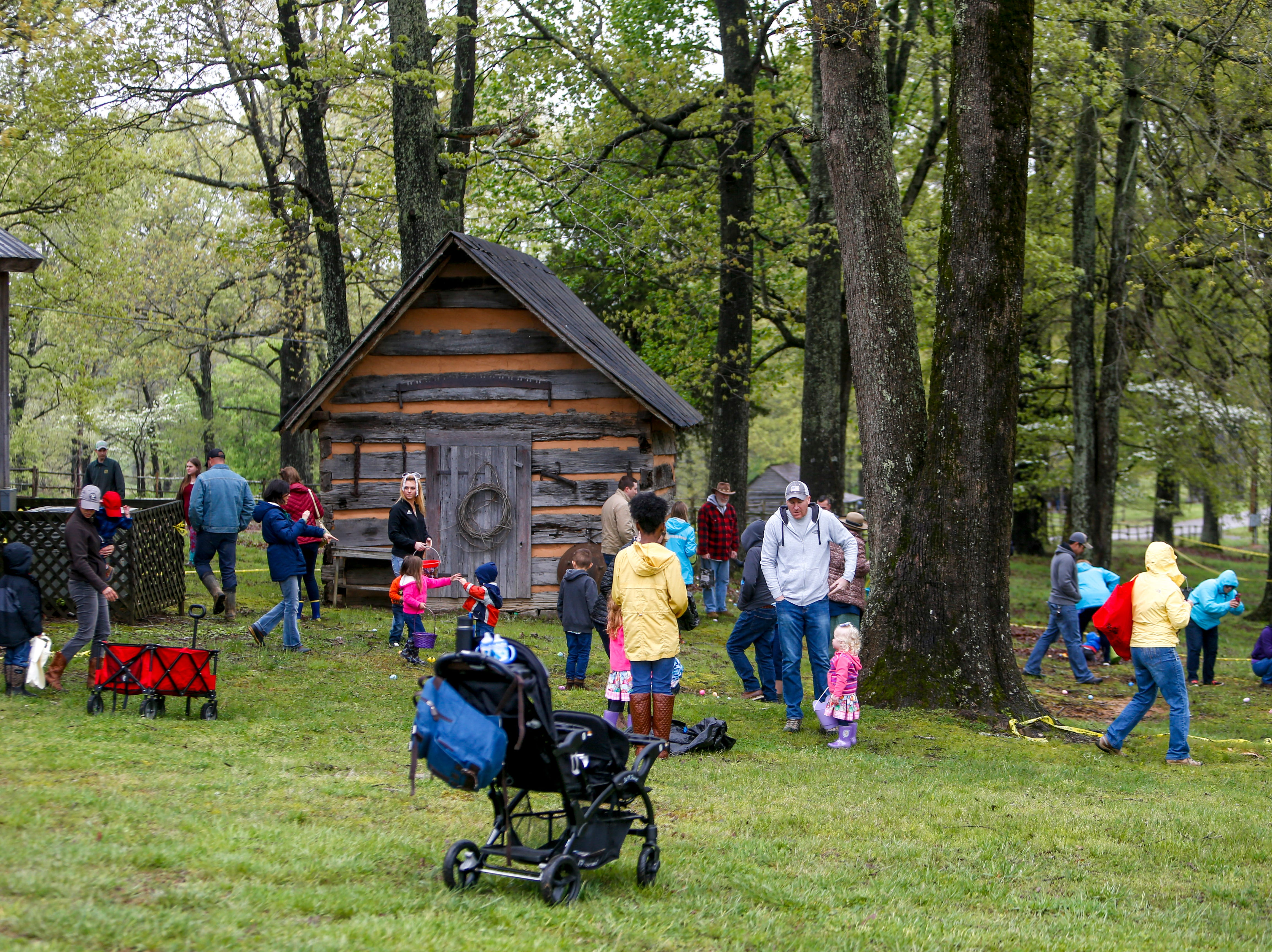 Families dot the grass under the trees in search of eggs at the annual Easter egg hunts at Historic Collinsville in Clarksville, Tenn., on Saturday, April 20, 2019.