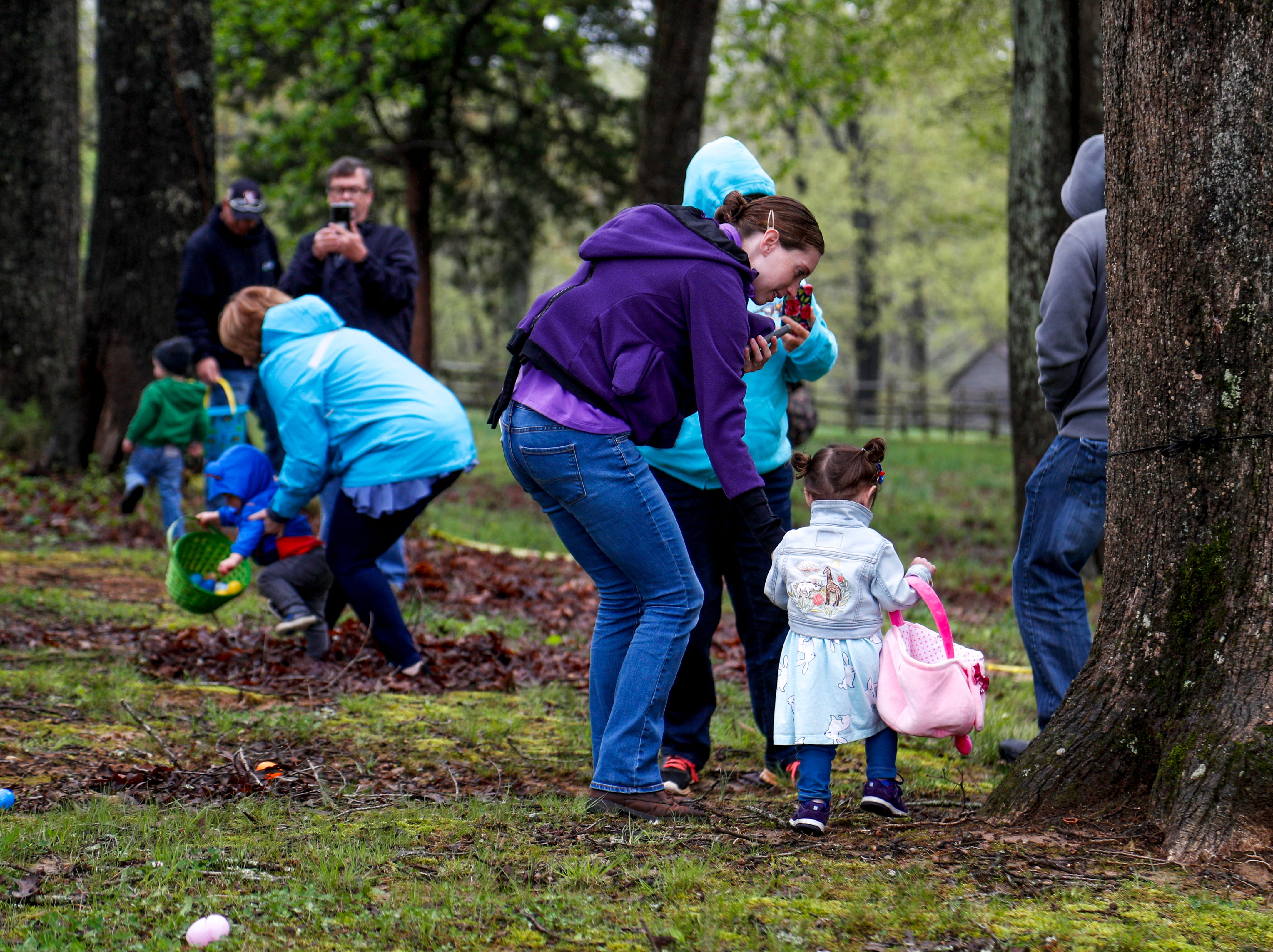 Families search for eggs together at the annual Easter egg hunts at Historic Collinsville in Clarksville, Tenn., on Saturday, April 20, 2019.