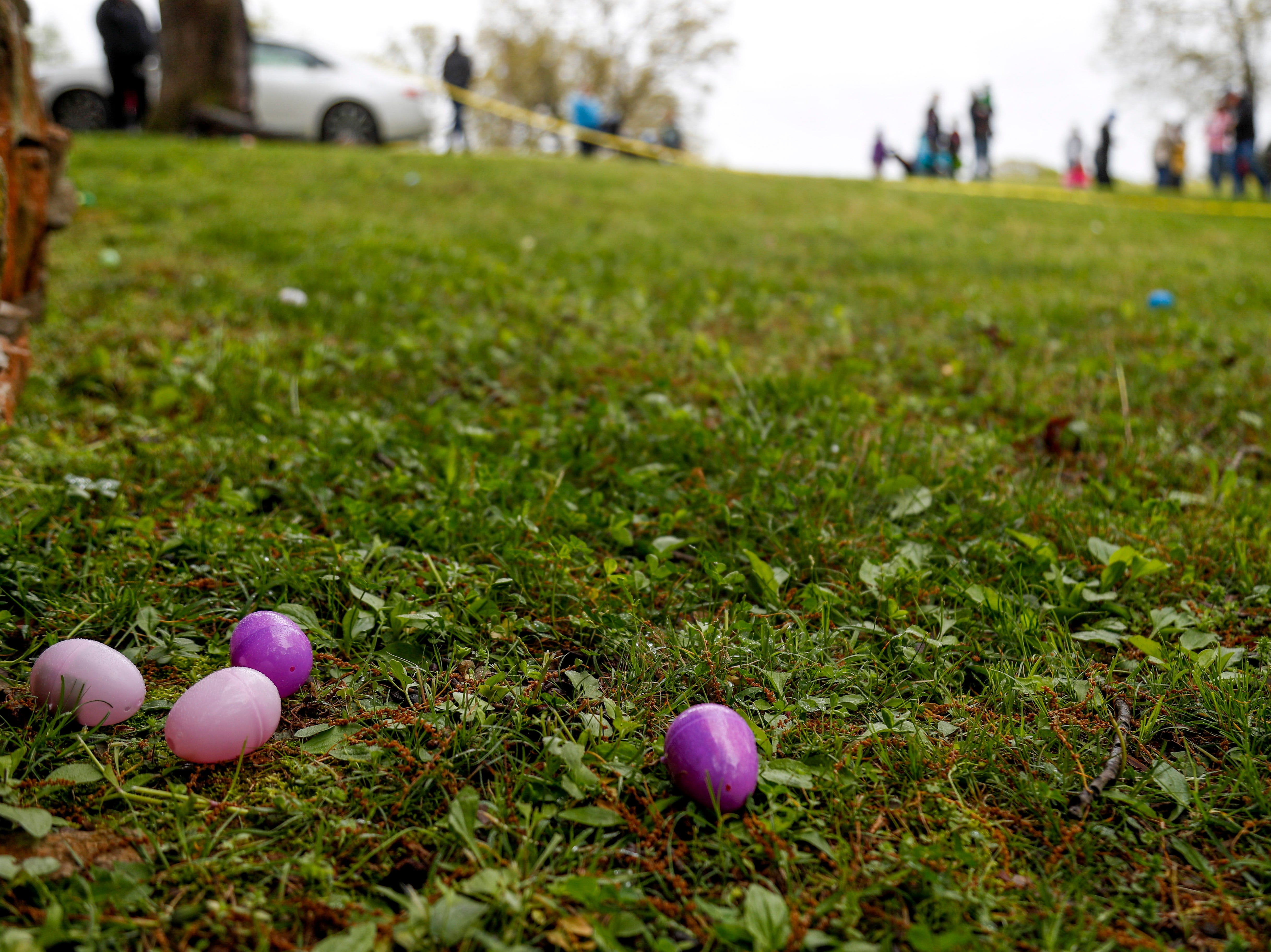 Eggs lie in the grass waiting to be found at the annual Easter egg hunts at Historic Collinsville in Clarksville, Tenn., on Saturday, April 20, 2019.
