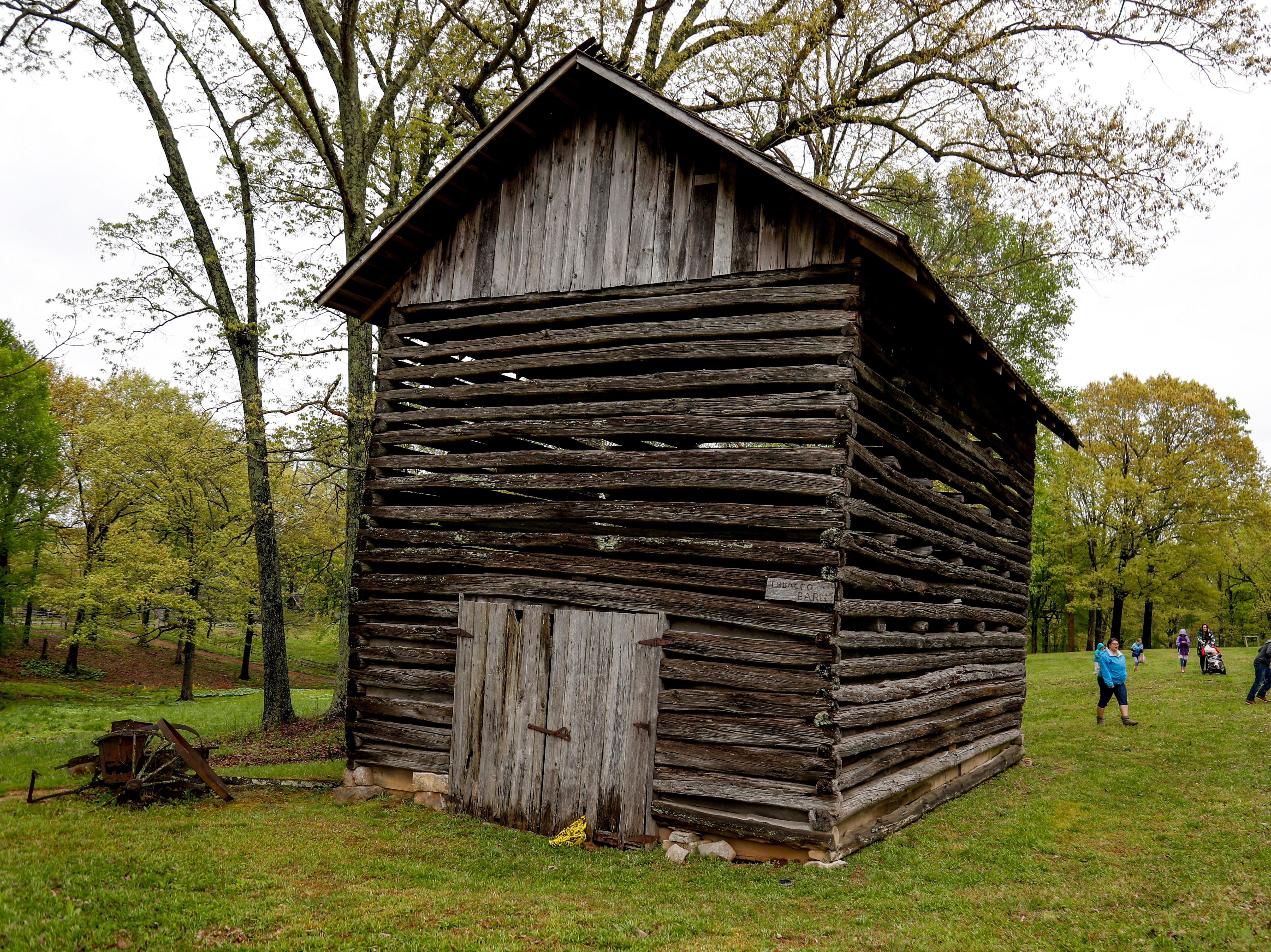 A tobacco storage barn sits tall after being searched during an egg hunt at the annual Easter egg hunts at Historic Collinsville in Clarksville, Tenn., on Saturday, April 20, 2019.