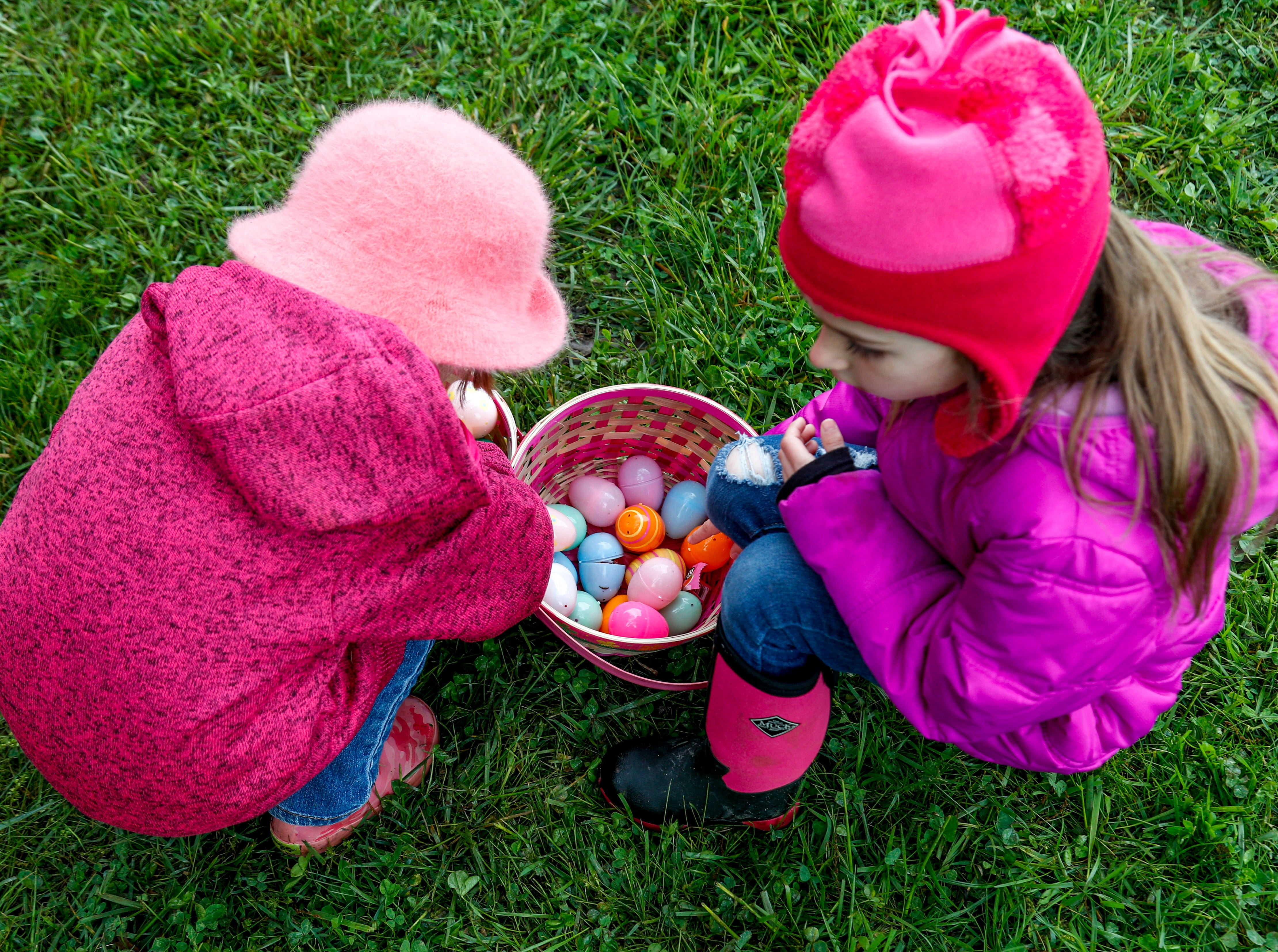 Sisters compare their loot of eggs from the hunt at the annual Easter egg hunts at Historic Collinsville in Clarksville, Tenn., on Saturday, April 20, 2019.