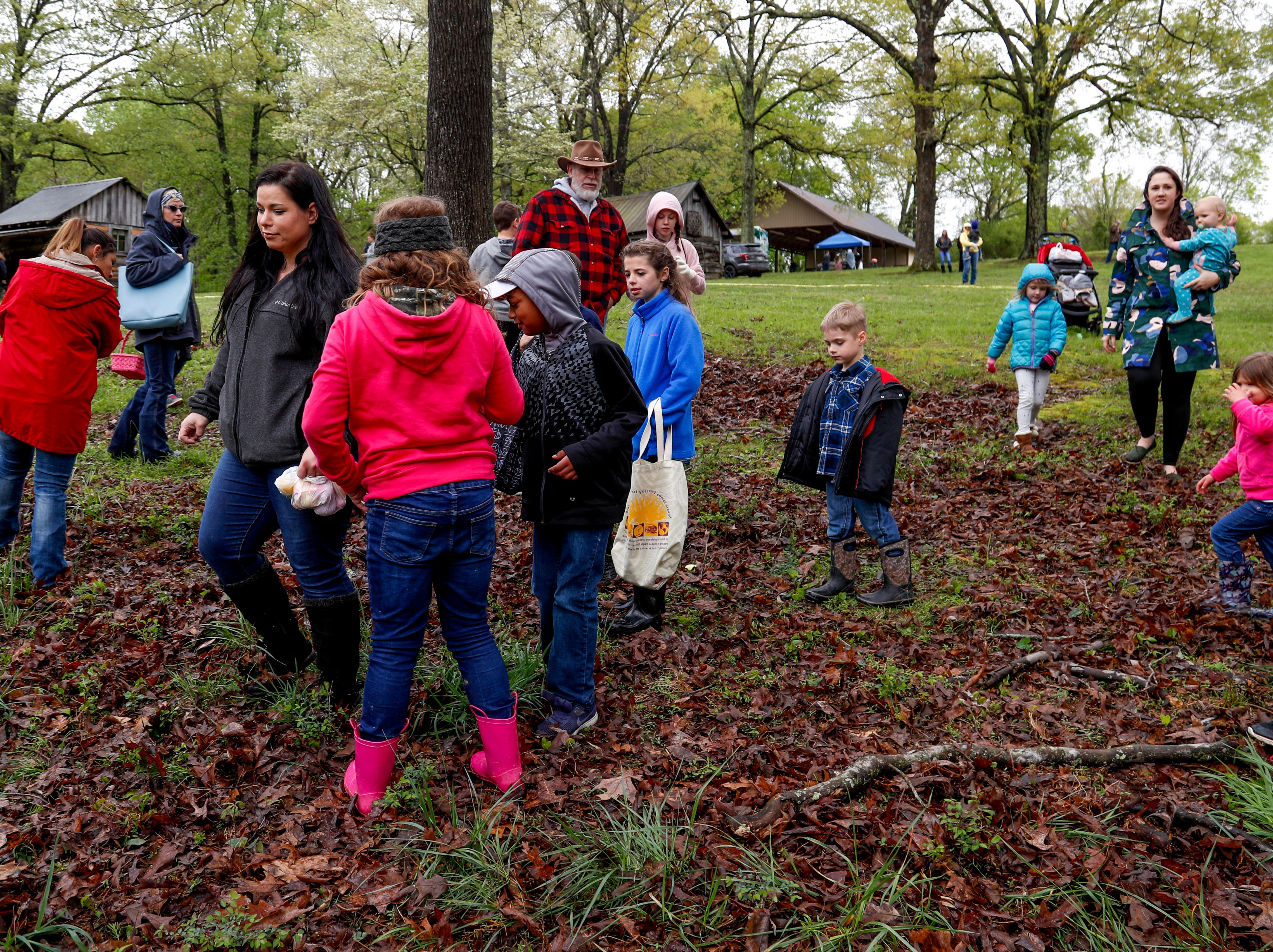 Participants gather in a central area of the egg hunting region to search for the still unfound golden egg at the annual Easter egg hunts at Historic Collinsville in Clarksville, Tenn., on Saturday, April 20, 2019.