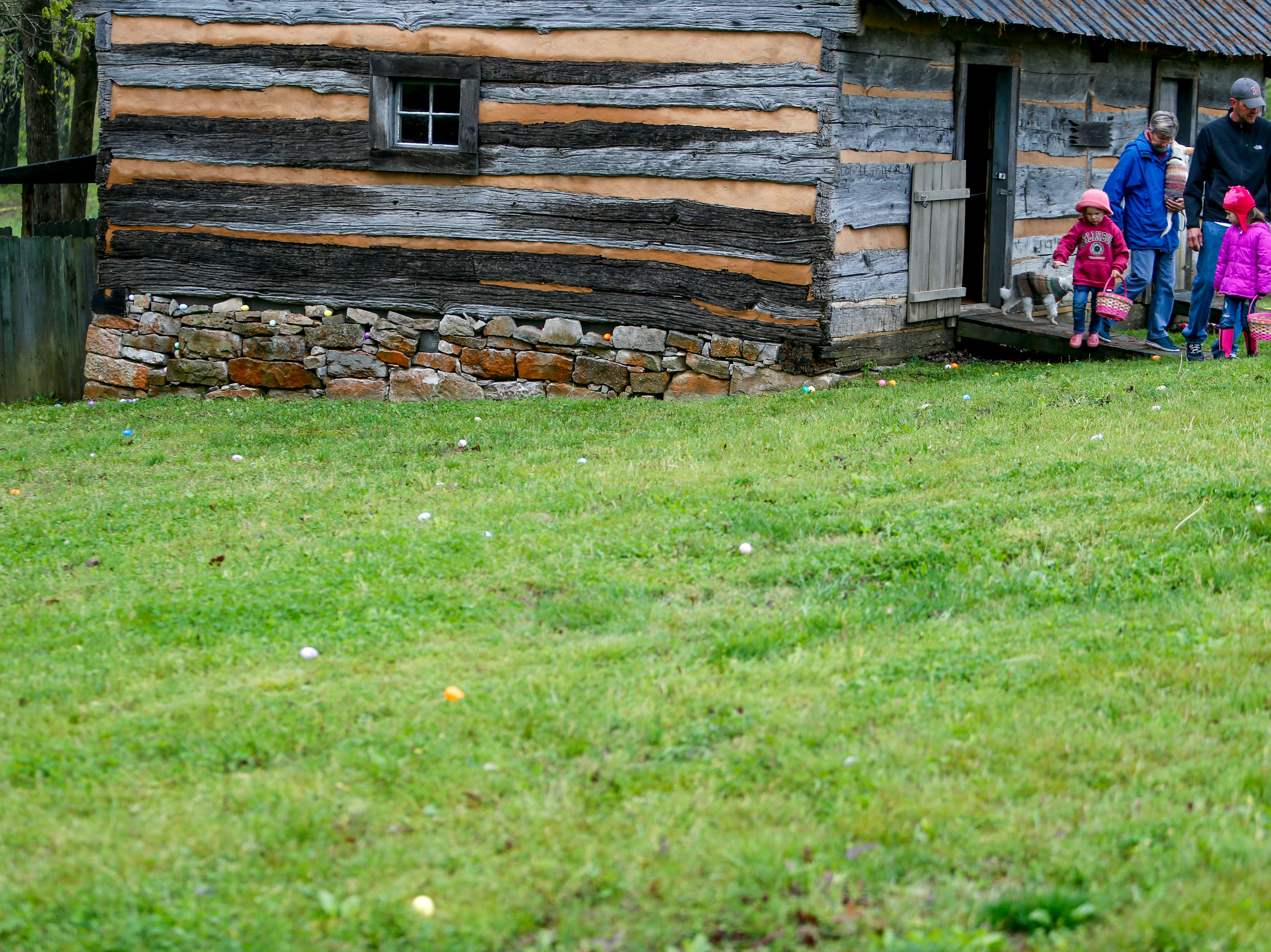 A family exits the nature center to see a field full of eggs at the annual Easter egg hunts at Historic Collinsville in Clarksville, Tenn., on Saturday, April 20, 2019.