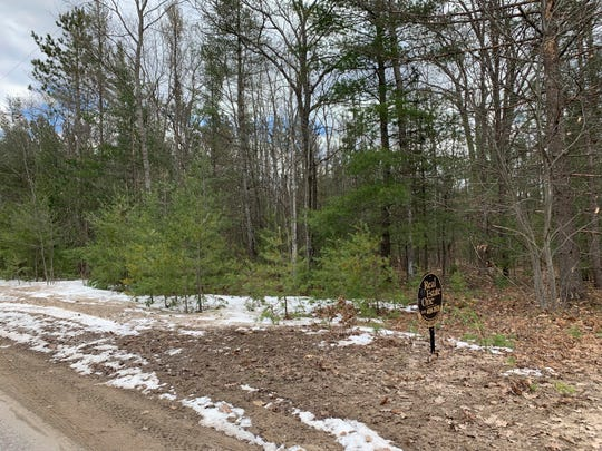 Land is shown April 12, 2019, for sale in the Village of Kalkaska, Mich. Kalkaska village leaders unanimously agreed to sell nearly 10 acres of its taxpayer-owned land specifically for future medical marijuana facilities. (Sheri McWhirter/Traverse City Record-Eagle via AP)
