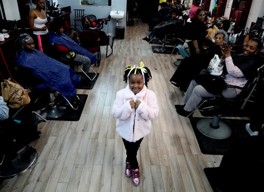 Chyna Fenderson, 7 of Detroit proudly shows off her Easter hairdo filled with ribbons and lots of curls done by hair stylist Nicora Lile at Little Willie's on Grand River Avenue in Detroit on Saturday, April 20, 2019.