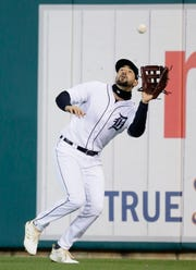 Right fielder Nicholas Castellanos #9 of the Detroit Tigers catches a fly ball hit by Eloy Jimenez #74 of the Chicago White Sox during the sixth inning at Comerica Park on April 19, 2019 in Detroit, Michigan.