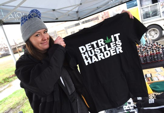 Jessica Byers, of Detroit Hustles Harder, Eastern Market, shows off the cannabis shirt during a 420 block party at Utopia Gardens.