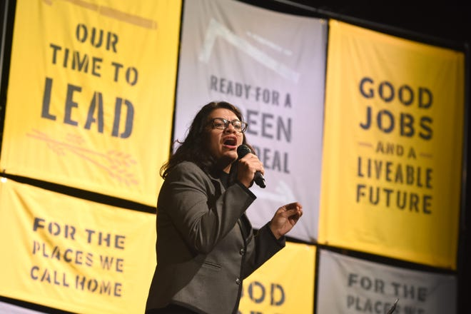 U.S. Rep. Rashida Tlaib, D-Detroit, addresses the crowd as part of an eight-city tour to promote the Green New Deal at the Bonstelle Theatre in Detroit on Friday.