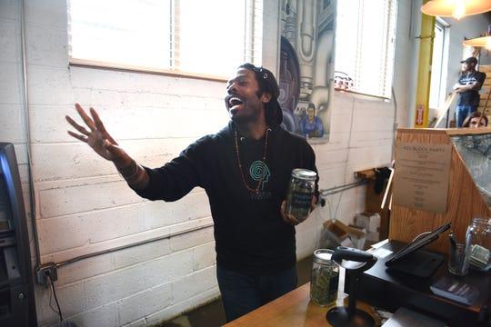 Budtender Rashon Massey wishes a customer a happy 420 Day.