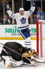 Toronto's Andreas Johnsson (18) celebrates a goal by Kasperi Kapanen on Bruins' Tuukka Rask, bottom, during the third period of Game 5 on Friday.
