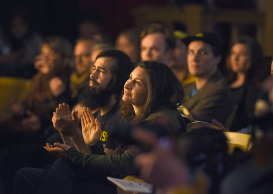 A large group attended a stop on an eight-city tour to promote the Green New Deal at the Bonstelle Theatre in Detroit on Friday.