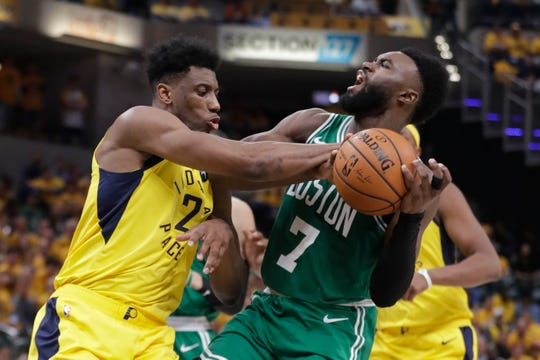 Pacers forward Thaddeus Young (21) blocks the shot of Celtics guard Jaylen Brown (7) during the second half on Friday.