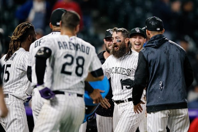 Charlie Blackmon, shown celebrating with teammates after hitting a walk-off home run in the 12th inning Friday night, and the Colorado Rockies wrap up a four-game series with the Philadelphia Phillies with a game at 1:10 p.m. Sunday at Coors Field in Denver.