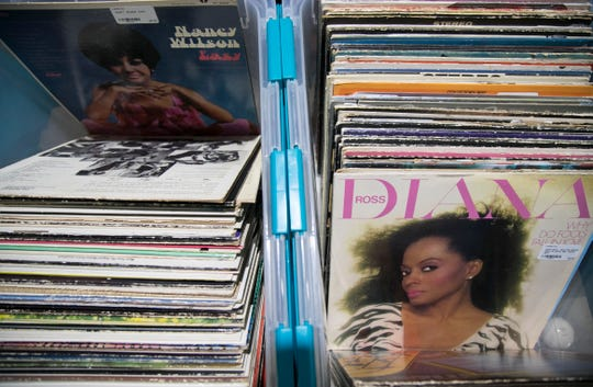 Two containers of records are the centerpiece to one of the booths at Wildwood Antique Mall in Fort Myers.